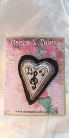 Two music-themed brooches