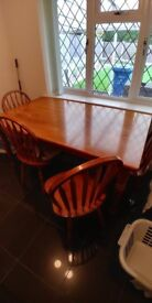 Pine (or another wood I am not sure) Dining Table and four Matching Chairs