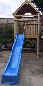 Refurbished Jungle gym / climbing frame with slide ,climbing wall , ladder, climbing rope.