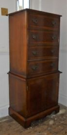 Tall boy yew wood chest over cupboard