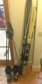 2 pairs of skis, 2 sets of poles and pair of ski boots