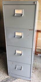 Grey metal four-drawer filing cabinet
