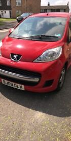 Red Peugeot 107