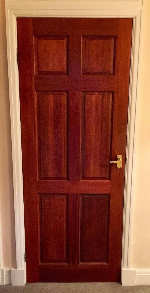 Mahogany stained solid hardwood panelled door