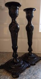 A pair of black candle sticks