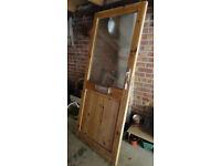 Half-glazed pine front door
