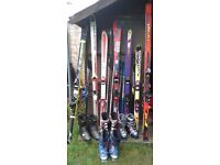 Skiing equipment, including boots, skis, poles