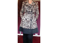 Leopard print rain coat in VERY good condition, like NEW
