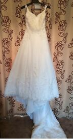 Quick Sell! New with tags stunning wedding dress. Delivery available.