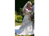 Stunning Wedding dress. Cream background, antique pink lace & sequins. Will fit from size 14 to 20.