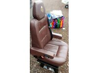 Brown leather motorhome captain's chair.