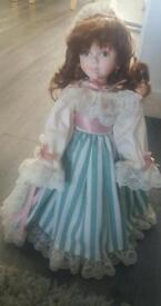 Limited edition China doll with frill dress