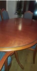 Red Cherry Wood Dining Table With 6 matching chairs