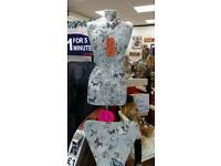 Ladies mannequin with stand and matching chair decoupaged with pretty butterfly paper.