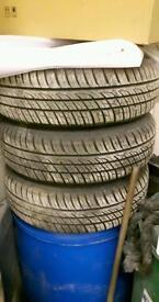 185/70/14 tyres on vauxhaull corsage rims like new