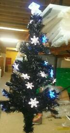 A brand new still boxed 5ft black fibre optic xmas tree with snowflake detail.