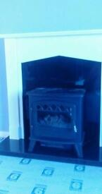 Fire surround and electric wood burning stove