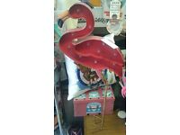 Retro themed metal flamingo solar powered garden lights, standing 32 inches.