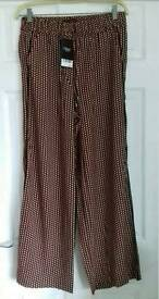Brand new £28 wide leg trousers patterned size 12