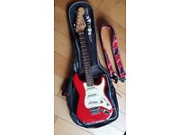 Electric Guitar ( Fender Squier) Red Mini Guitar & Accessories In a Immaculate Condition