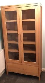 Oak Glass cabinet with drawer.