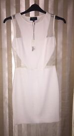 White midi dress from the abbey Clancy range, brand new with tags. Size 10 would fit a 12 also.