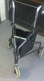 TRI-WALKER. Sturdy walker with effective brakes and a shopping basket.