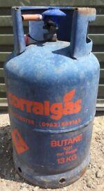 Nearly full 13kg butane gas bottle with regulator