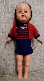 Vintage Roddy head turning walker doll, approx. 13 inches high, made in England written on back.