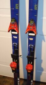Pair of blue Kastle Syncap O2 skis for sale with Salamon Equipe bindings.