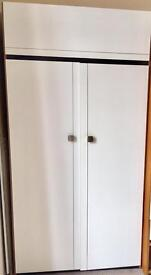 Two double wardrobes with top box