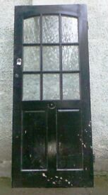 A 1920'S/30'S GLAZED, SOLID OAK FRONT DOOR.