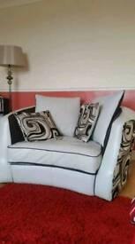 Cream leather cuddle chair