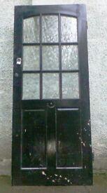 A 1920'S/30'S GLAZED, SOLID OAK FRONT DOOR.