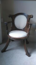 Lovely antique newly upholstered chair. Unusual shape.