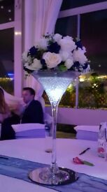 Tall champagne glass arrangement in cream and navy including glass/flower arrangement/mirror plate