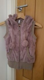 Fur hooded gilet