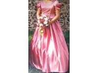 Three dusty pink bridesmaid dresses