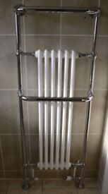 Chrome and white heated towel rail in top condition