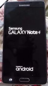 Samsung Galaxy Note 4 Smartphone (2014) with spare batteries