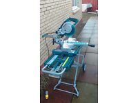 makita sliding mitre saw and rolling stand.
