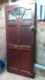 Solid hardwood Door 1980 mm high by 835 mm wide in excellent condition, coloured leaded glass.