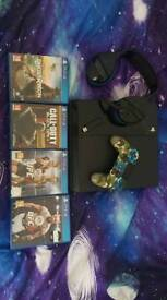 PS4 2TB HEADSET AND 4 GAMES