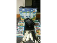 Nintendo Wii U 32GB with controllers, games, cables