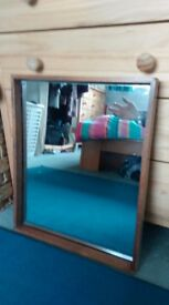 Mirror with protruding wooden frame