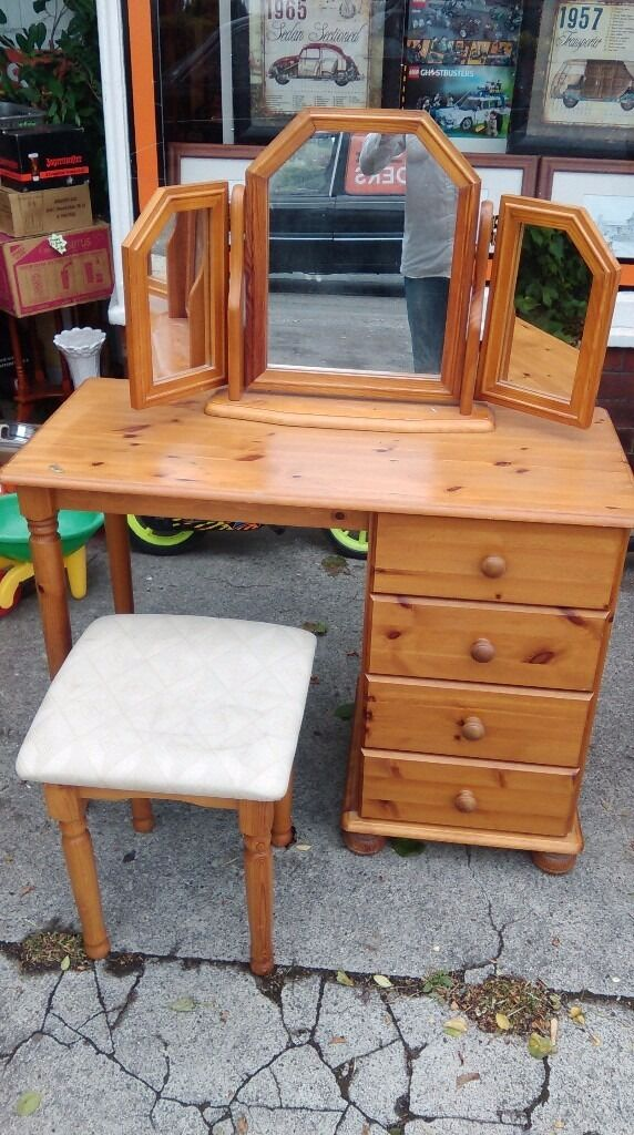 Pine Dressing Table, triple mirror and stool Bedroom Setin Ossett, West YorkshireGumtree - Pine dressing table with 4 drawers. Size is 1 meter wide, 47 cm deep, 75cm high. Pine stool size 40 x 40 x 48cm high. Pine folding triple mirror. Used but in good condition. May deliver locally for fuel costs
