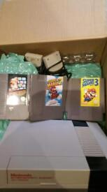 Nes console with 3 mario games