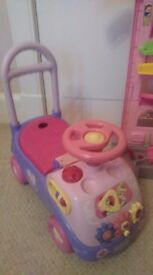 Sit on push along musical Disney toy