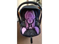 Kiddy Evolution car seat with isofix base. Comes with newborn headrest