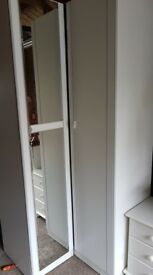 White and grey wardrobes, chest of drawers and bridging/wall units
